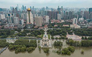 组图:长江水位超过警戒 中国南部多处洪灾