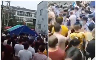 警察与民众扭打在一起。(视频截图)