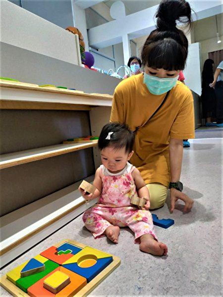 台中市第12座公共托育家园13日在大鹏国小开幕,也是西屯区首座社区公托。