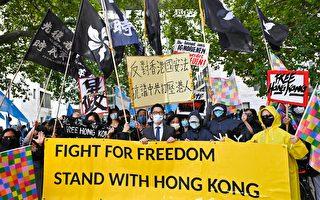 组图:王毅访德 罗冠聪到柏林为香港发声