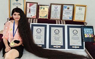 激励他人 印度长发公主将两米秀发捐博物馆