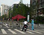 中國17省市現疫情 北京防控措施不斷升級