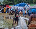 组图:海地强震又遭风暴袭击 逾两千人死亡