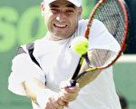 阿格西3月30日在納斯達克網賽六度封王。(法新社)
