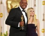 奥斯卡影帝佛瑞斯特怀特克和女星瑞丝薇斯朋(Photo credit should read ROBYN BECK/AFP/Getty Images)