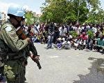 2008年4月海地民眾爆發示威活動,聯合國部隊介入維護安全。(AFP PHOTO/Thony BELIZAIRE )