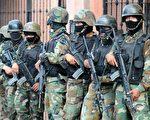 9月22日,宏都拉斯軍隊包圍巴西駐宏國大使館,遭罷黜的總統賽拉亞(Manuel Zelaya)藏身此地。 (AFP PHOTO/Jose Cabezas)