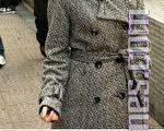 陈巧文日前被法庭裁定袭警罪名不成立。下图为陈巧文于今年1月1日在中联办后门抗议时的场面。(大纪元资料图片)