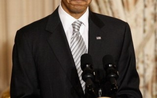 维吉尼亚州联邦法官13日裁定,奥巴马总统签署的健保改革法案中一项关键性规定违宪。(Chip Somodevilla / 2010 Getty Images)