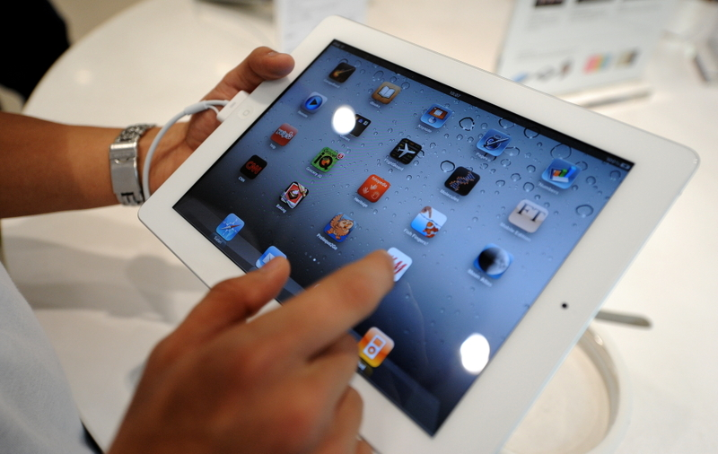 蘋果公司近日在iPad供應鏈名單中,剔除了大陸最大的觸屏工廠歐菲光。圖為iPad示意圖。(NOEL CELIS/AFP)