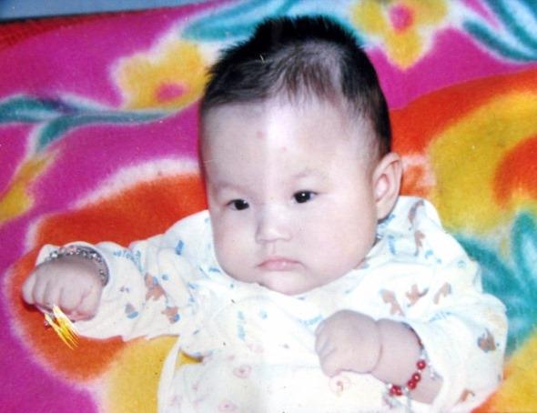 珊珊的百日照(出生十天被綁架)(圖片來源:明慧網)
