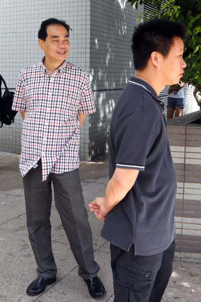 疑凶為中資機構、燕京啤酒公司經理關子昂,僱主為青關會主席、燕京啤酒總經理洪偉成(左)。他昨日也有出現法庭。(攝影:潘在殊/大紀元)