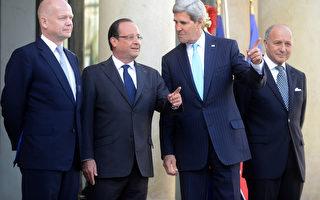 9月16日,法國總統奧朗德和外長法比尤斯在愛麗捨宮接見美、英兩位外長。(Antoine Antoniol/Getty)