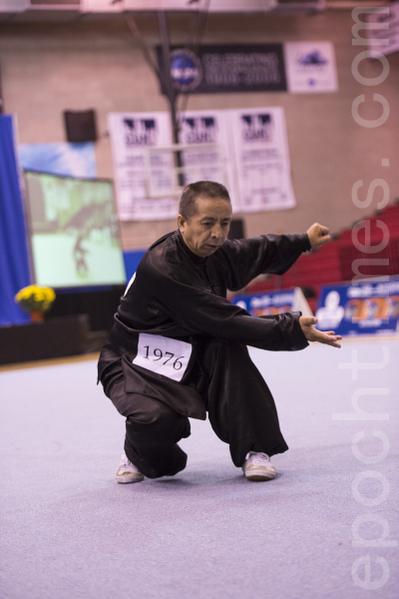 两年前从大陆赴美参加第三届新唐人武术大赛并获得男子器械组金牌的王百利,2013年第四届比赛获得男子拳术组的金牌。(戴兵/大纪元)