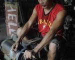 劳委会职训局21日公布9月分的外劳人数,总计目前在台外劳总数已达47.5万人,再度创下历史新高。(AFP)