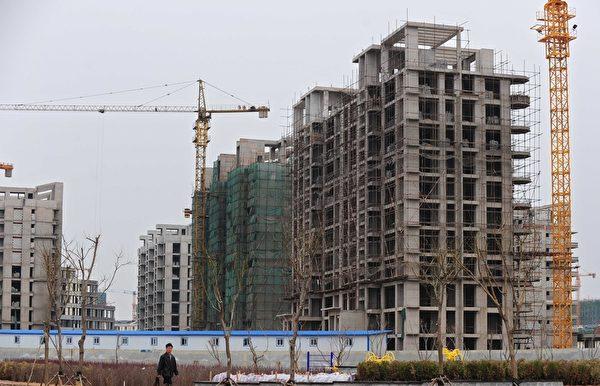 29日,中共国务院发展研究中心主任李伟称,中国房地产泡沫正在破裂。(AFP)