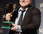 2012年9月8日,霍夫曼憑藉《大師》與華金•菲尼克斯共享威尼斯影帝殊榮。(Ian Gavan/Getty Images)