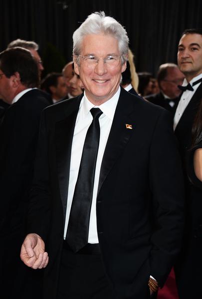 李察•基尔于2013年再次成为奥斯卡颁奖嘉宾。(Frazer Harrison/Getty Images)