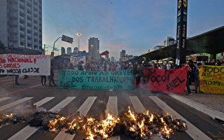 巴西地铁罢工暂停 总统怕被嘘缺席开幕式