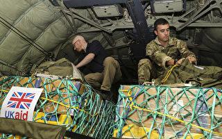 美续空袭伊拉克叛军 西方加紧空投物资