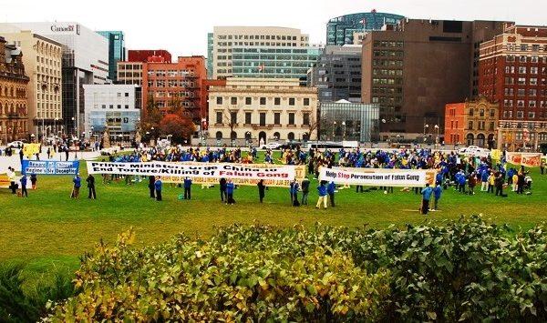 法輪功加首都集會 多政要促哈珀總理籲中共停止迫害