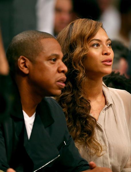 嘻哈音乐人杰斯、碧昂丝夫妇2014年5月资料照。(Elsa/Getty Images)