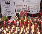 在寒风冷雨中,华埠烛光悼念刘文健的活动如常进行,数百名民众自发在临时搭建的帐篷下,悼念因公殉职的华人警员刘文健。(蔡溶/大纪元)