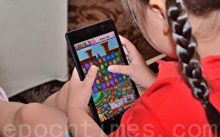 台孩童手机娱乐 调查:3成玩超龄游戏