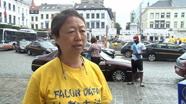 比利時法輪功學員 Jessica接受媒體採訪。(大紀元)