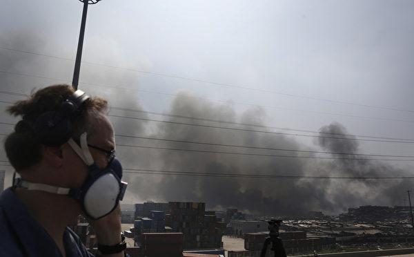8月12日,天津爆炸现场(ChinaFotoPress/Getty Images)
