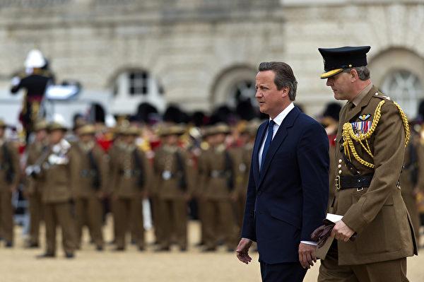 英国首相卡梅伦在纪念二战胜利70周年的仪式上。(Ben A. Pruchnie/Getty Images)