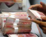 截至目前,中國今年已經有7家公司出現違約,中國信用風險加劇,標普和穆迪評級機構今年9月份都對中國銀行業的評級進行了下調(AFP)