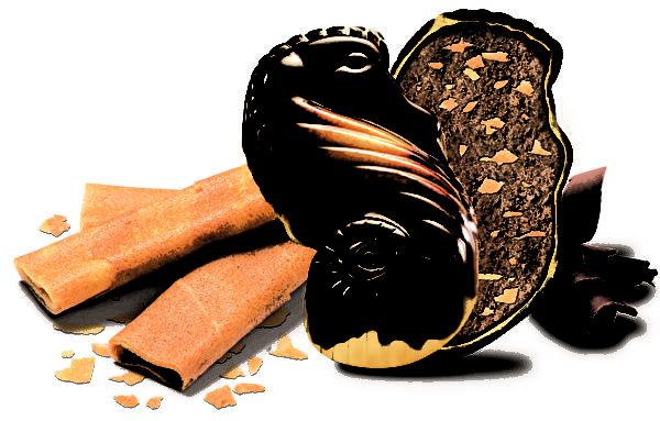 吉利蓮仍然沿用上世紀五十年代的配方,榛子醬製作的果仁餡,將榛子的碎粒攪拌到牛奶巧克力中,加入焦糖,再在傳統的銅壺中進行烤制。(吉利蓮提供)