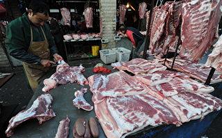 大陆猪肉价格近期大幅上涨,大陆整体生猪价格比去年同期上涨逾50%。(STR/AFP/Getty Images)