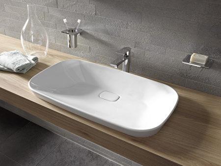 採圓弧形收邊的洗手盆。(TOTO提供)