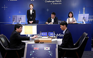 SEOUL, SOUTH KOREA - MARCH 15:  In this handout image provided by Google, South Korean professional Go player Lee Se-Dol (R) watches as Google DeepMind's lead programmer Aja Huang (L) puts the Google's artificial intelligence program, AlphaGo's first stone, during the last Google DeepMind Challenge Match on March 12, 2016 in Seoul, South Korea. Lee Se-dol is playing a five-match series against a computer program developed by a Google, AlphaGo.  (Photo by Google via Getty Images)
