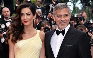 喬治.克魯尼(右)攜愛妻一起亮相首映禮紅毯。(Pascal Le Segretain/Getty Images)