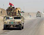伊拉克部队在当地时间周一(5月30日)清晨4时进入费卢杰(Fallujah)。图为伊拉克支持政府部队5月28日抵达费卢杰边界。(AHMAD AL-RUBAYE/AFP/Getty Images)