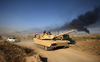 伊拉克进攻IS手中战略重镇 美军空袭掩护