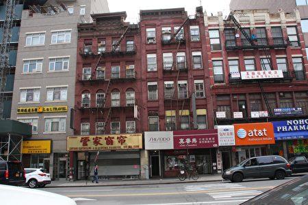 包厘街83、85號樓。