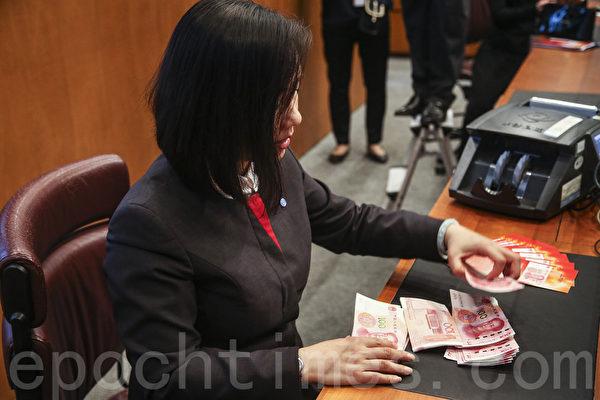 盘古智库:人民币年底可能跌破6.8