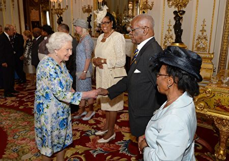 Britain's Queen Elizabeth II (L) shakes hands with Governor-General of Barbados Elliott Belgrave (2R) during a reception ahead of the Governor General's lunch in honour of the Queen's 90th birthday at Buckingham Palace in London on June 10, 2016. Britain started a weekend of events to celebrate the Queen's 90th birthday. The Queen and the Duke of Edinburgh along with other members of the royal family will attend a national service of thanksgiving at St Paul's Cathedral on June 10, which is also the Duke of Edinburgh's 95th birthday. / AFP / POOL / John Stillwell (Photo credit should read JOHN STILLWELL/AFP/Getty Images)