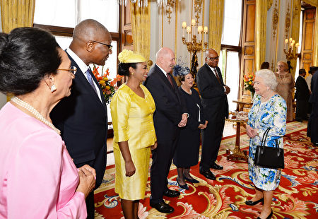 Britain's Queen Elizabeth II (R) meets guests during a reception ahead of the Governor General's lunch in honour of the Queen's 90th birthday at Buckingham Palace in London on June 10, 2016. Britain started a weekend of events to celebrate the Queen's 90th birthday. The Queen and the Duke of Edinburgh along with other members of the royal family will attend a national service of thanksgiving at St Paul's Cathedral on June 10, which is also the Duke of Edinburgh's 95th birthday. / AFP / POOL / John Stillwell (Photo credit should read JOHN STILLWELL/AFP/Getty Images)