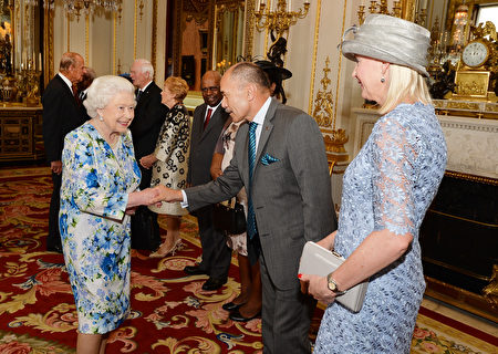 Britain's Queen Elizabeth II (R) shakes hands with New Zealand's Governor-General Jerry Mateparae (2R) during a reception ahead of the Governor General's lunch in honour of the Queen's 90th birthday at Buckingham Palace in London on June 10, 2016. Britain started a weekend of events to celebrate the Queen's 90th birthday. The Queen and the Duke of Edinburgh along with other members of the royal family will attend a national service of thanksgiving at St Paul's Cathedral on June 10, which is also the Duke of Edinburgh's 95th birthday. / AFP / POOL / John Stillwell (Photo credit should read JOHN STILLWELL/AFP/Getty Images)
