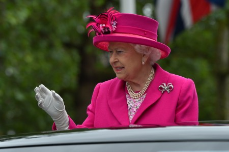 "LONDON, ENGLAND - JUNE 12: Queen Elizabeth II waves to guests attending ""The Patron's Lunch"" celebrations for The Queen's 90th birthday on The Mall on June 12, 2016 in London, England. 10,000 guests have gathered on The Mall for a lunch to celebrate The Queen's Patronage of more than 600 charities and organisations. The lunch is part of a weekend of celebrations marking Queen Elizabeth II's 90th birthday and 63 year reign. The Duke of Edinburgh and other members of The Royal Family are also in attendance. During the lunch a carnival parade will travel down The Mall and around St James's Park. (Photo by Bruce Adams - WPA Pool/Getty Images)"