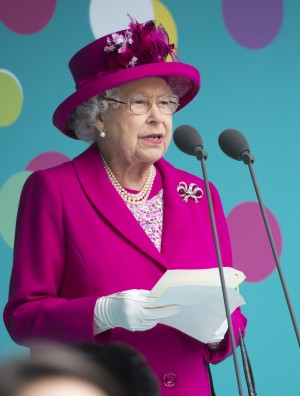 "LONDON, ENGLAND - JUNE 12: Queen Elizabeth II speaks to guests attending ""The Patron's Lunch"" celebrations for The Queen's 90th birthday on The Mall on June 12, 2016 in London, England. 10,000 guests have gathered on The Mall for a lunch to celebrate The Queen's Patronage of more than 600 charities and organisations. The lunch is part of a weekend of celebrations marking Queen Elizabeth II's 90th birthday and 63 year reign. The Duke of Edinburgh and other members of The Royal Family are also in attendance. During the lunch a carnival parade will travel down The Mall and around St James's Park. (Photo by Arthur Edwards - WPA Pool/Getty Images)"