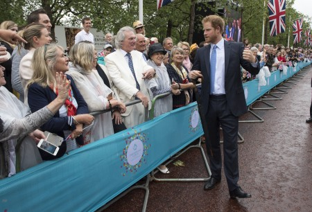 "LONDON, ENGLAND - JUNE 12: Prince Harry greets guests attending ""The Patron's Lunch"" celebrations for The Queen's 90th birthday on The Mall on June 12, 2016 in London, England. 10,000 guests have gathered on The Mall for a lunch to celebrate The Queen's Patronage of more than 600 charities and organisations. The lunch is part of a weekend of celebrations marking Queen Elizabeth II's 90th birthday and 63 year reign. The Duke of Edinburgh and other members of The Royal Family are also in attendance. During the lunch a carnival parade will travel down The Mall and around St James's Park. (Photo by Arthur Edwards - WPA Pool/Getty Images)"