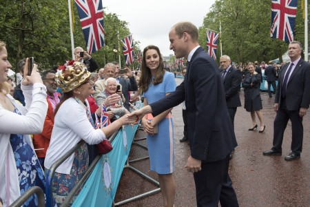 "LONDON, ENGLAND - JUNE 12: Prince William, Duke of Cambridge and Catherine, Duchess of Cambridge greet guests attending ""The Patron's Lunch"" celebrations for The Queen's 90th birthday on The Mall on June 12, 2016 in London, England. 10,000 guests have gathered on The Mall for a lunch to celebrate The Queen's Patronage of more than 600 charities and organisations. The lunch is part of a weekend of celebrations marking Queen Elizabeth II's 90th birthday and 63 year reign. The Duke of Edinburgh and other members of The Royal Family are also in attendance. During the lunch a carnival parade will travel down The Mall and around St James's Park. (Photo by Arthur Edwards - WPA Pool/Getty Images)"