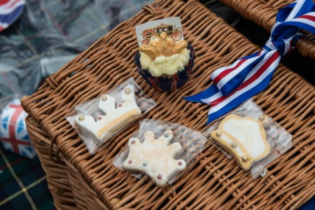 "LONDON, ENGLAND - JUNE 12: Homemade cakes and biscuits are seen on a wicker hamper basket as members of the public gather in the rain in Green Park for a picnic and to watch The Queen's Patronage on a big screen during ""The Patron's Lunch"" celebrations for The Queen's 90th birthday on June 12, 2016 in London, England. 10,000 guests have gathered on The Mall for a lunch to celebrate The Queen's Patronage of more than 600 charities and organisations. The lunch is part of a weekend of celebrations marking Queen Elizabeth II's 90th birthday and 63 year reign. The Duke of Edinburgh and other members of The Royal Family are also in attendance. During the lunch a carnival parade will travel down The Mall and around St James's Park. (Photo by Chris Ratcliffe/Getty Images)"