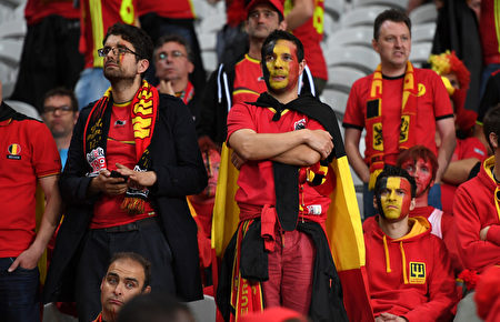 LILLE, FRANCE - JULY 01: Dejected Belgium supporters are seen after the UEFA EURO 2016 quarter final match between Wales and Belgium at Stade Pierre-Mauroy on July 1, 2016 in Lille, France. (Photo by Michael Regan/Getty Images)
